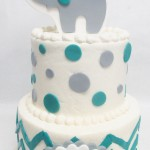 two tier cake with elephant and polka dots
